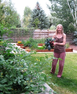 Teri with kale and rhubarb harvest